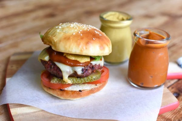 Burger with mustard and sauce