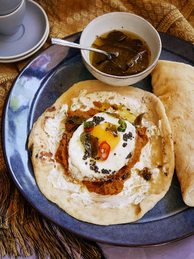 Curried Lentil Smash and Egg Naan Breakfast Roll